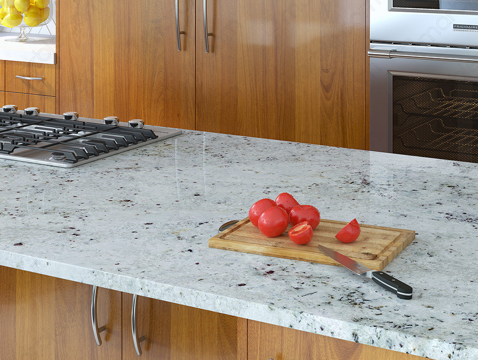 protecting the granite countertop by using a cutting board to prepare food