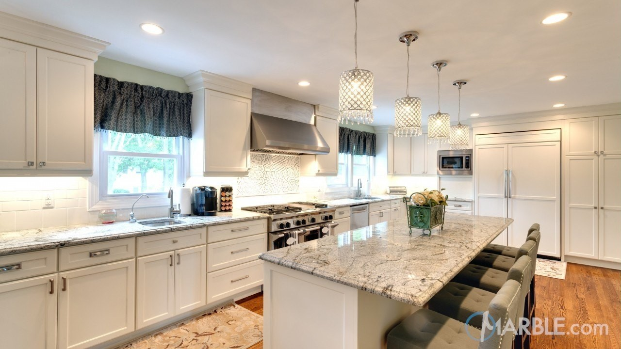 If You Re Seeking A Sophisticated Look To Go Along With Your White Cabinets Ilhabella Granite Counters Can Be The Right Choice For It Is Light Grey