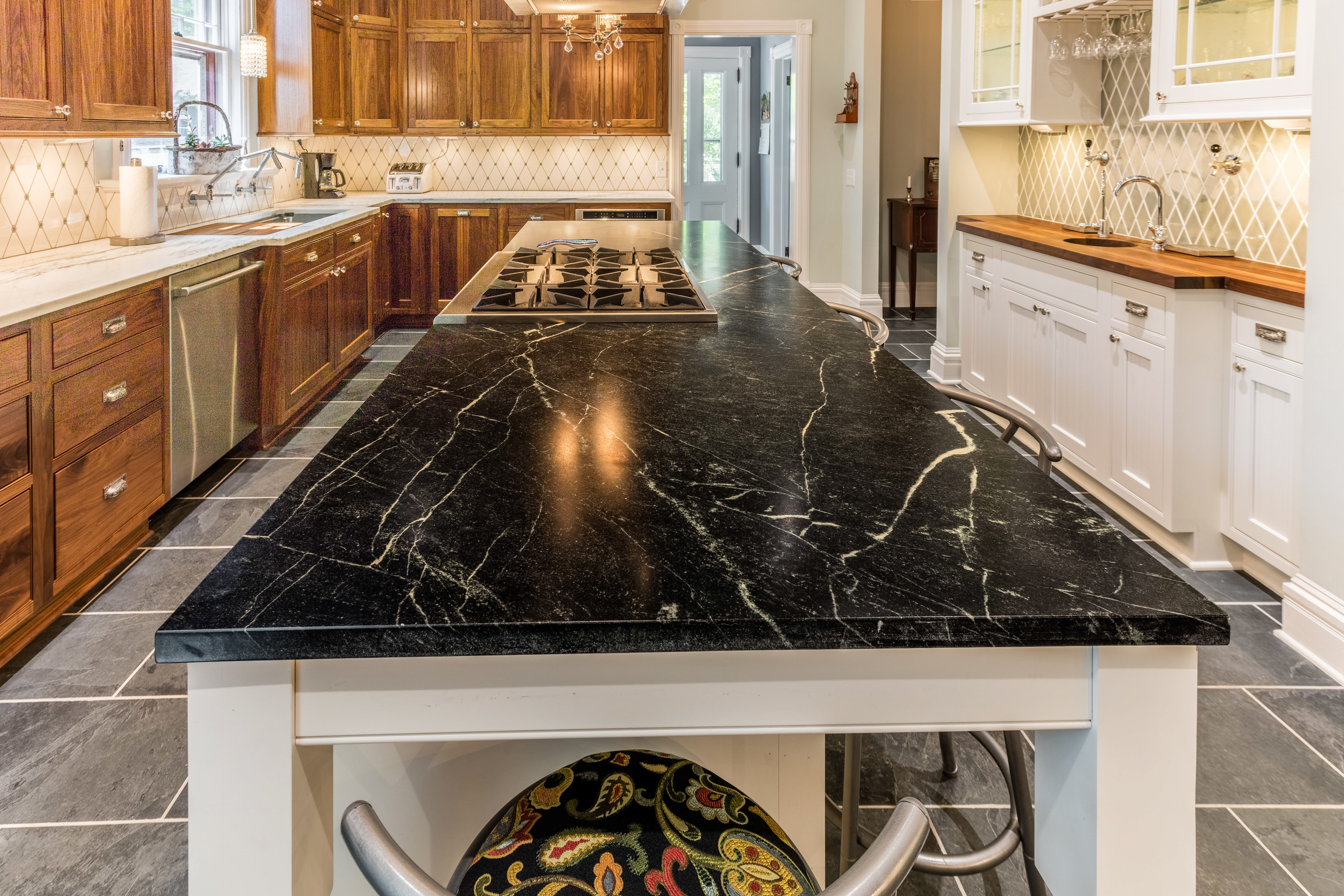 Soapstone counters for the kitchen on countertops with tile, countertops with granite, countertops with maple cabinets, countertops with breakfast bar, countertops with hickory cabinets, countertops with linoleum,