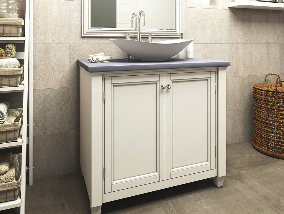 Bathroom has white cabinets white washbasin with blue quartz countertop