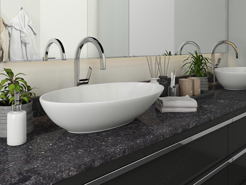 Bathroom has white washbasin with black quartz countertop