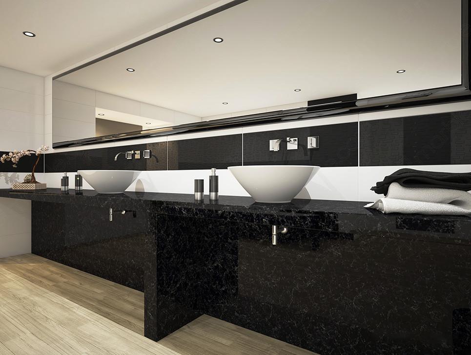 Black quartz countertop and white washbasin with bathroom accessories