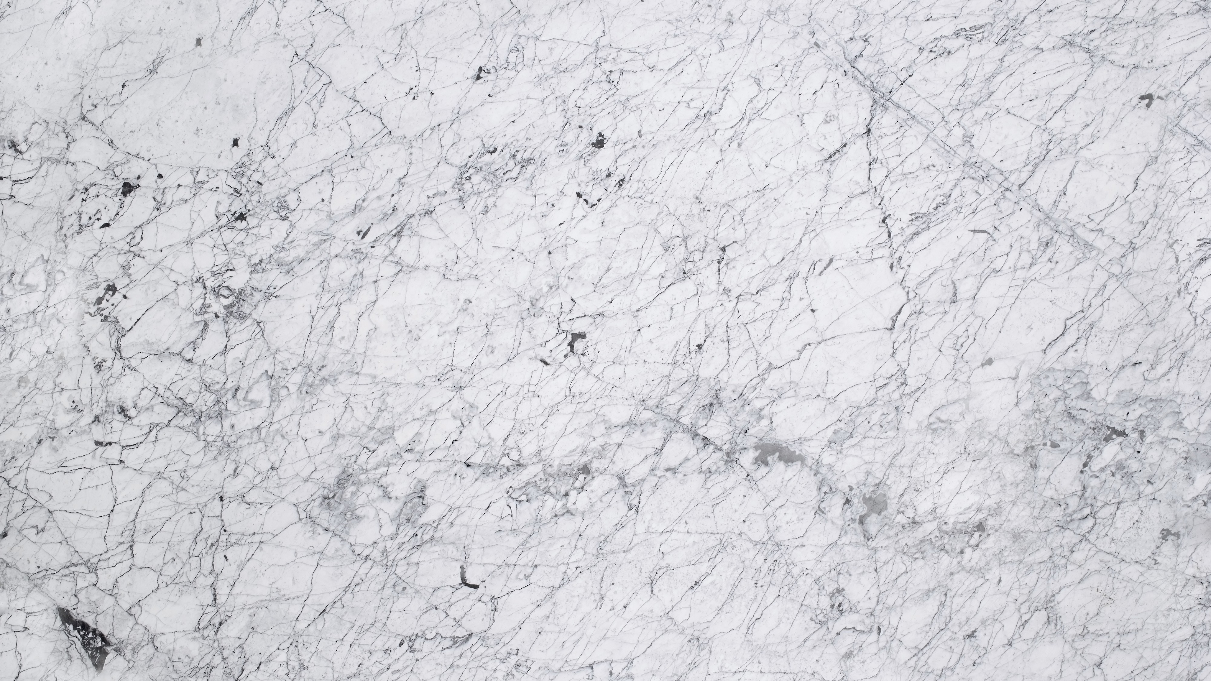 White Veined Marble Dark Kitchen