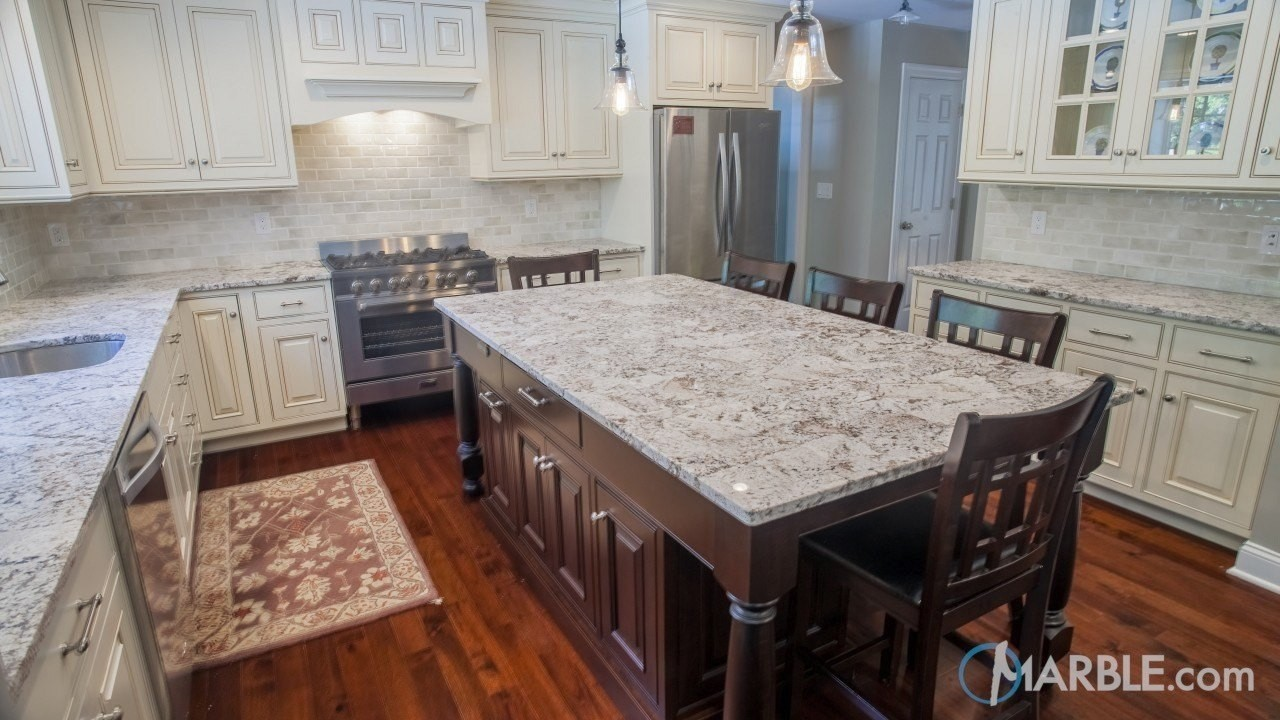 Bianco antico granite white cabinets for Granite on white cabinets