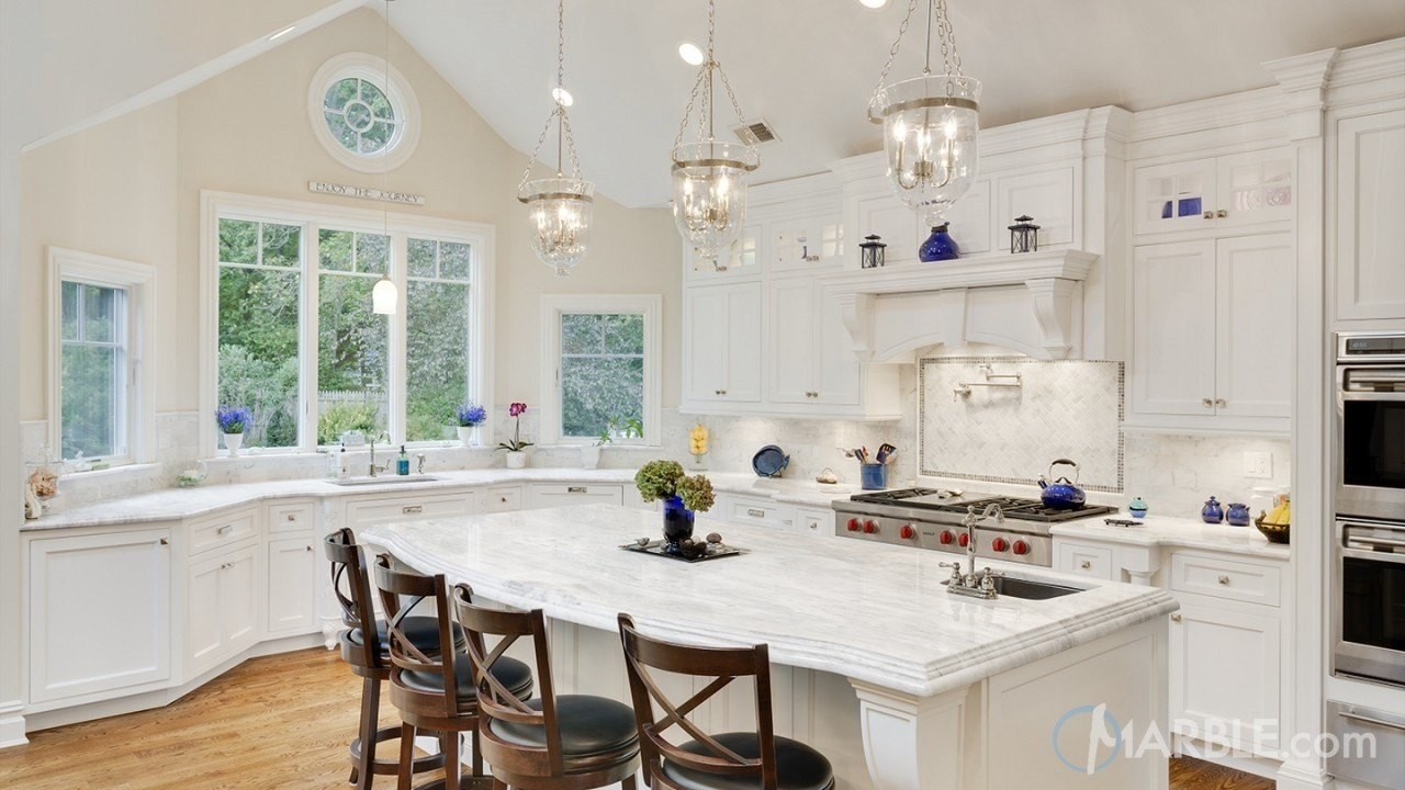 Classic White Quartzite On This Kitchen Island Is A Beautiful Focal Point  In This All White Kitchen
