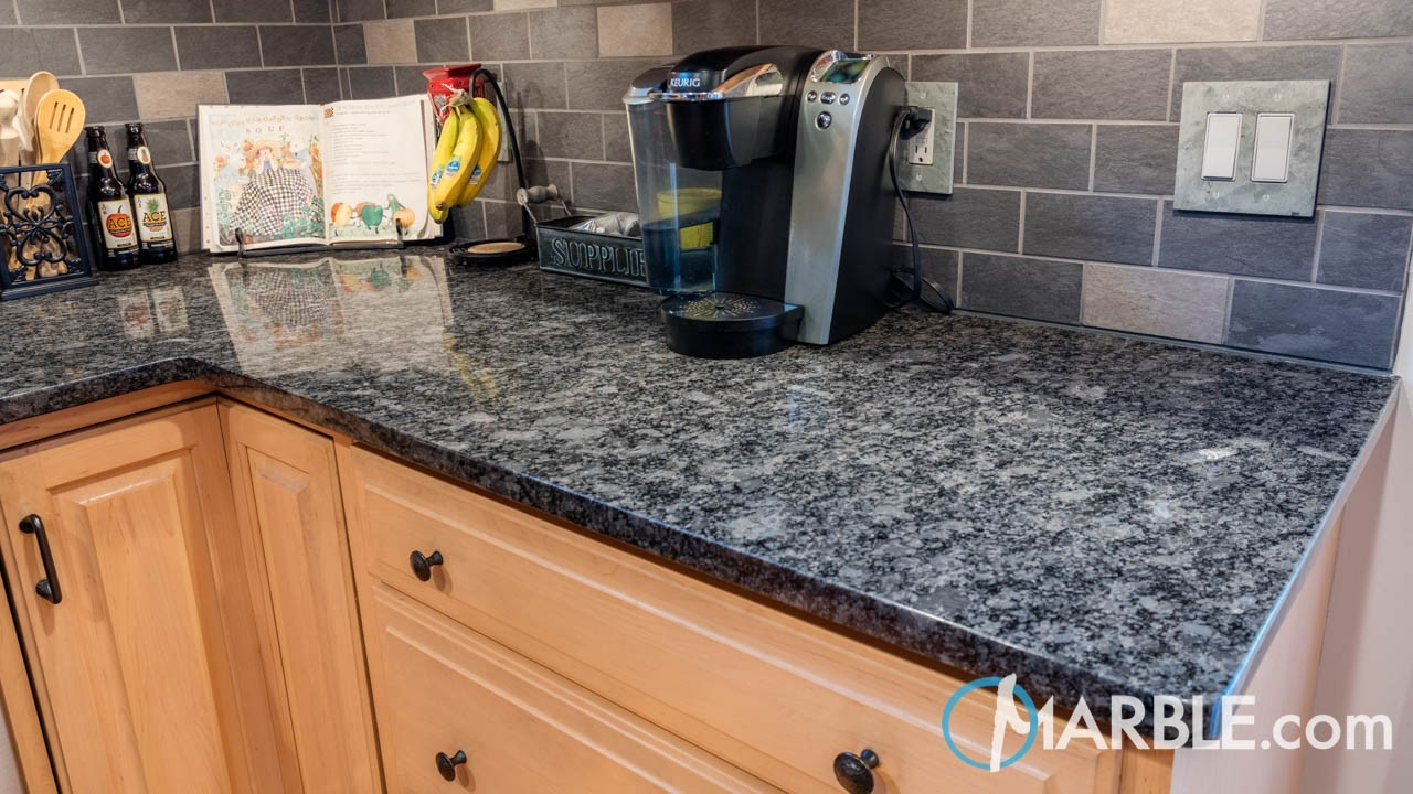 The Silver Flecks Scattered Across The Surface Of The Granite Used In This  Kitchen Are The Perfect Accent For Stainless Steel Appliances Selected By  The ...