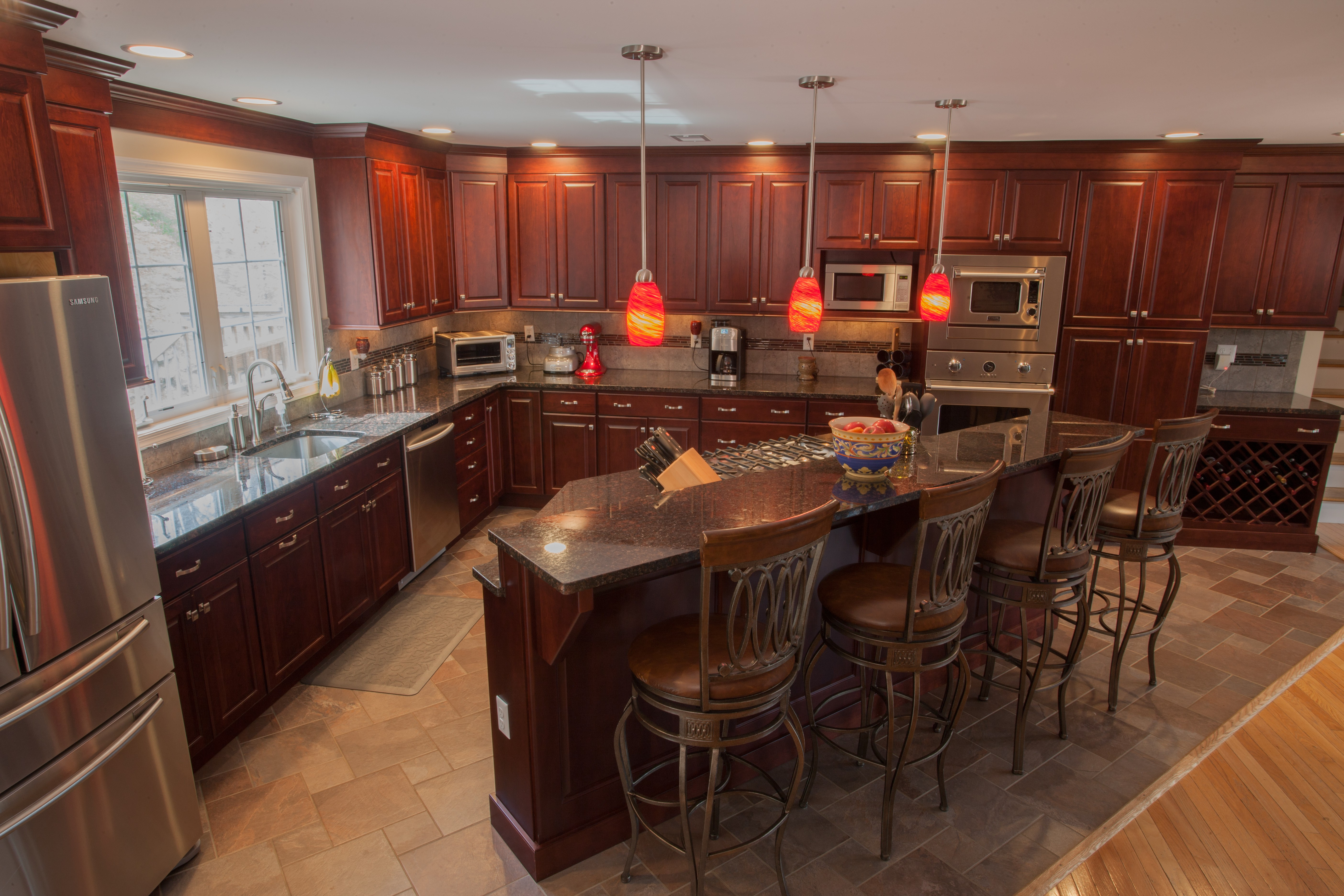 Tan Brown Is A Dark Black And Brown Natural Stone Countertop That Features  Large Burgundy Flecks Throughout. In This Kitchen, The Red Accents Of The  Granite ...