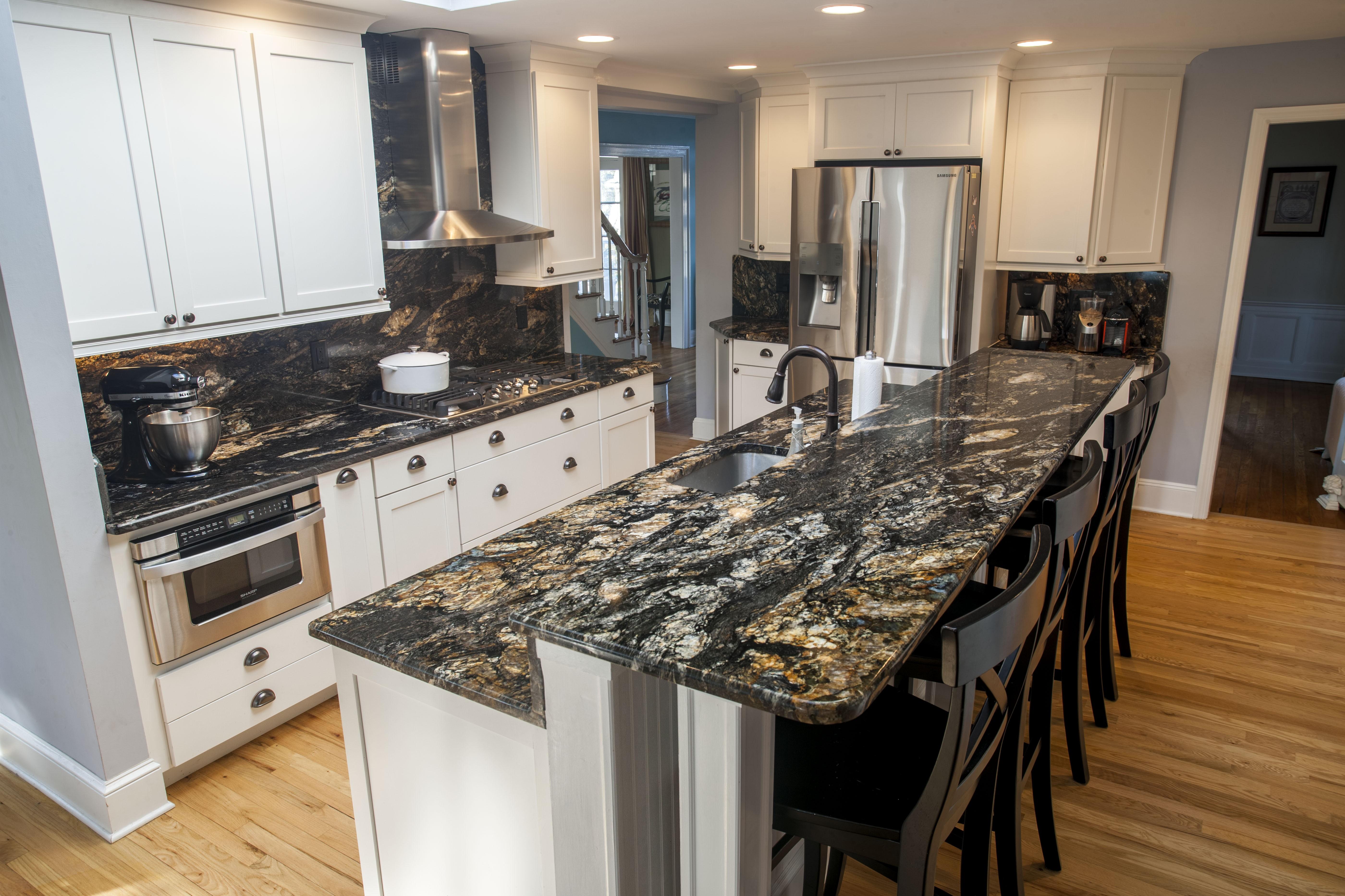 Beige with black and white kitchen granite countertops for Black and beige kitchen