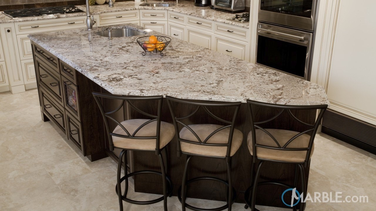 the bianco antico granite kitchen island at regualr counter height looks stunning here and is perfect for gatherings