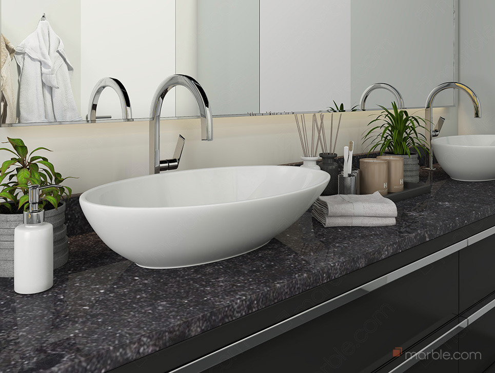 Bathroom has white washbasin with black quartz countertop