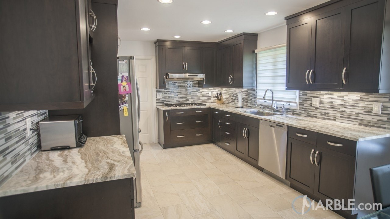 The Dark Cabinets In This Kitchen Look Beautiful With These Fantasy Brown  Quartzite Countertops