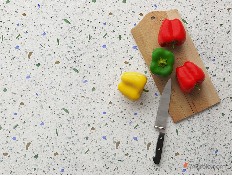 Glass countertop with a cutting board, knife, and different color peppers