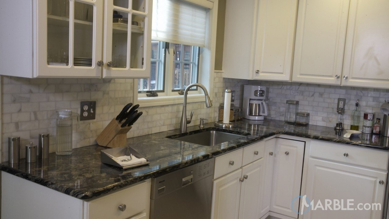 bianco romano also known as romano dream and toscano is a greyish white granite from brazil with exquisite quartz burgundy deposits throughout tile kitchen countertops cabinets86 cabinets