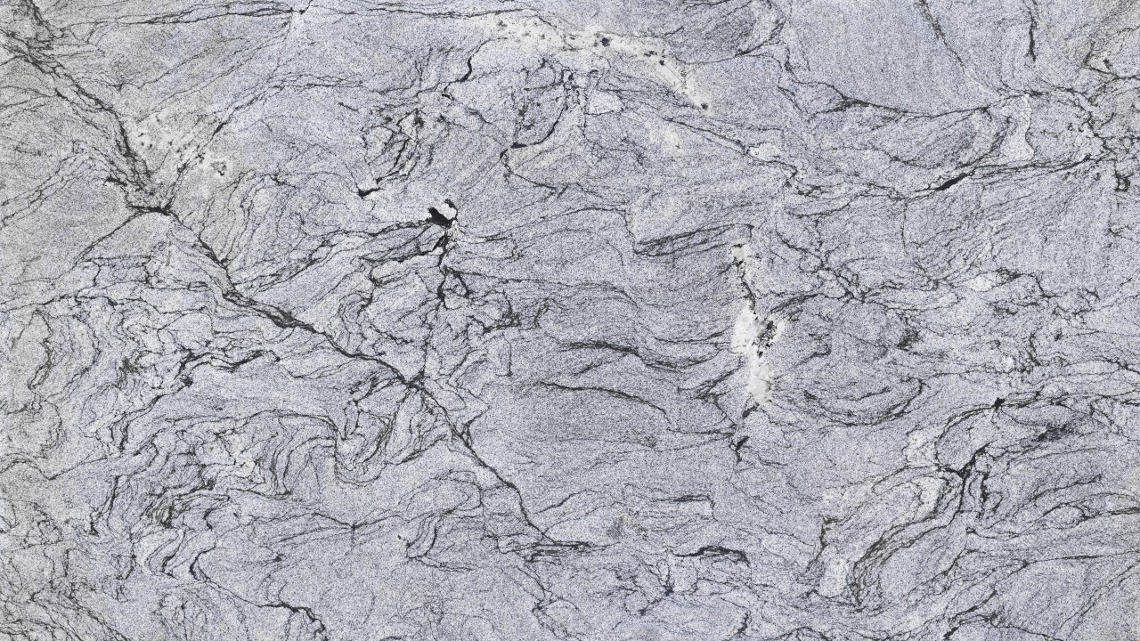 Light gray in color with black veining and black speckles scattered consistently throughout the stone similar to marble in appearance ilhabela granite is
