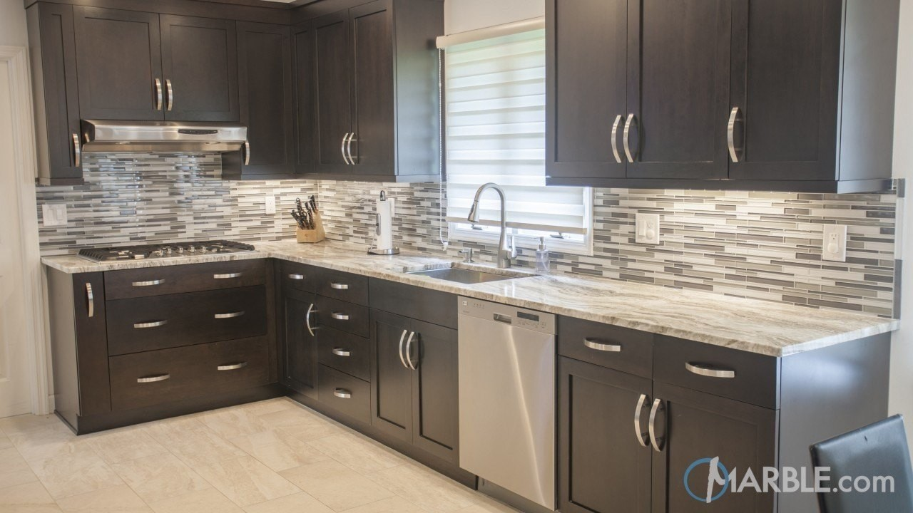 Countertops are fantasy brown granite the backsplash is marble - This Kitchen Utilizes Fantasy Brown Quartzite To Add Depth To A Modern Design The Wavy Veins Of This Stone Add A Natural Flow To This Otherwise Symmetrical