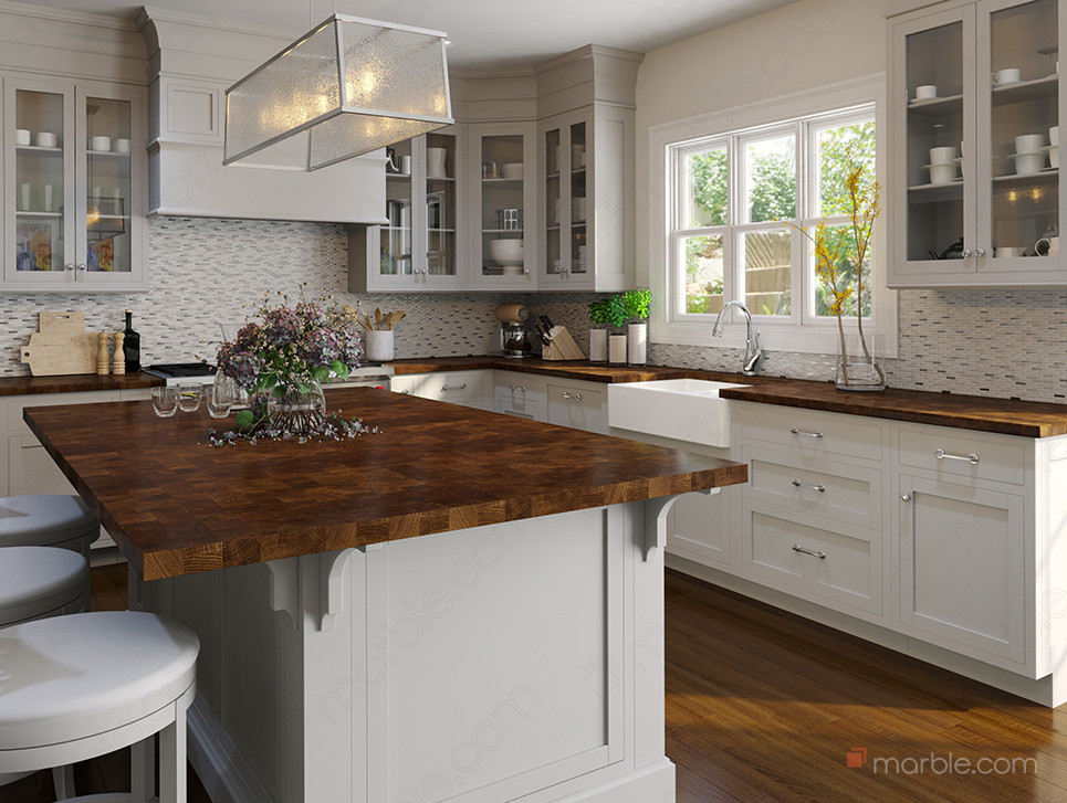 Butcher block countertop with white cabinets