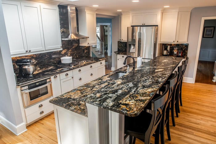 White Cabinets Paired With Dark Countertops Marble Com