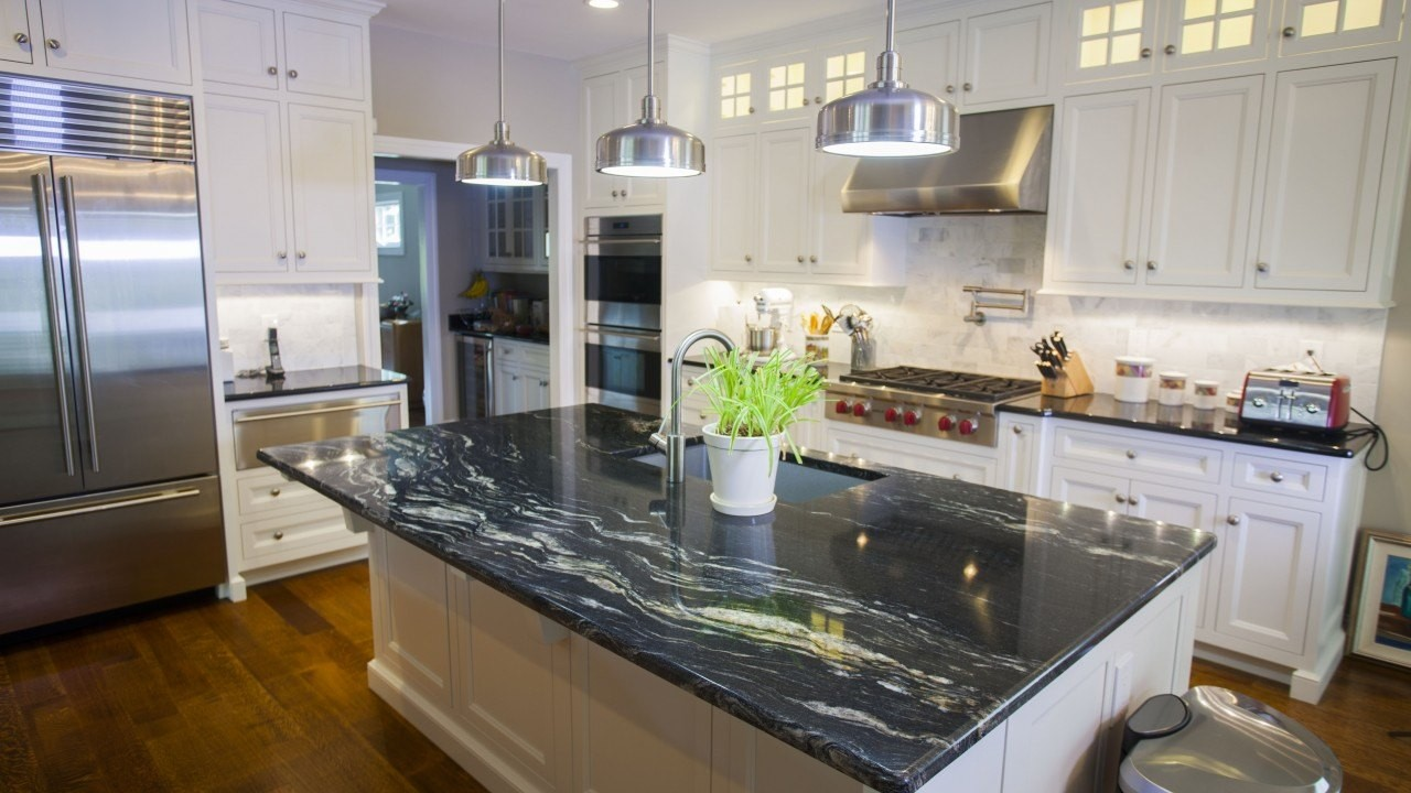 Ocean Black Honed Countertops On White Kitchen Picture