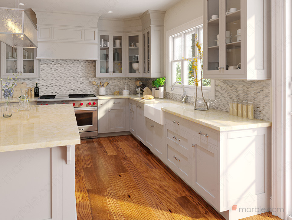White kitchen with wood floors has cream cultured marble countertop