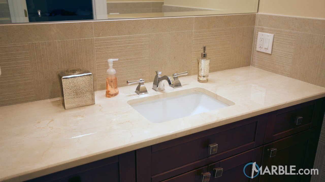 Crema Marfil Marble Countertop In A Classic Bathroom
