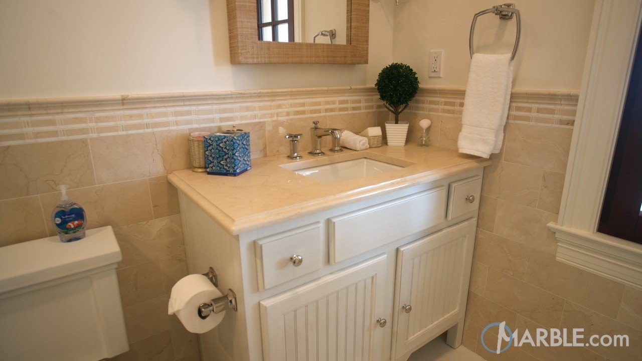 Crema marfil marble vanity in a elegant guest bathroom - Best paint color for crema marfil bathroom ...