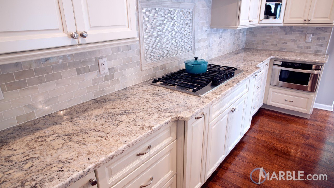 Snow white granite kitchen countertops for White cabinets granite countertops