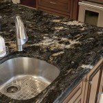Cosmic Black Granite Kitchen Countertops With A Multi-Layer Island | Marble.com