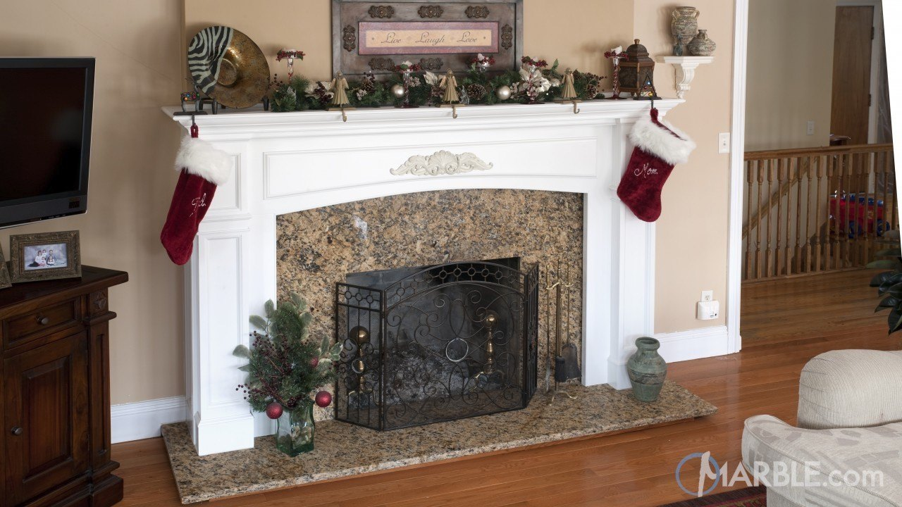 Giallo napole granite fireplace surrounds for Marble for fireplace surround