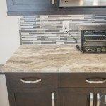 Fantasy Brown Quartzite Kitchen Counter With Dark Cabinets | Marble.com