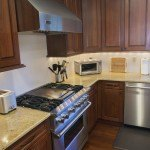 Madura Gold Granite Kitchen Countertop & Two Tier Island | Marble.com