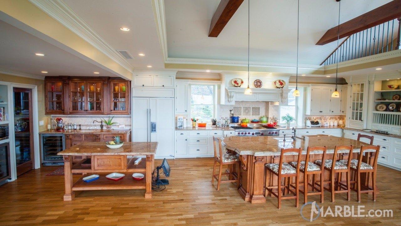 Madura Gold Kitchen Granite Countertops with Oak Cabinets | Marble.com